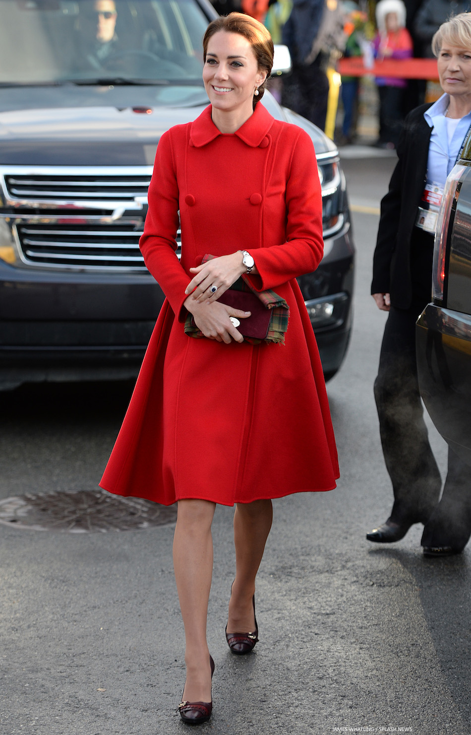 cfe308dbb5a95 Kate repeats red Carolina Herrera coat for the France vs. Wales ...