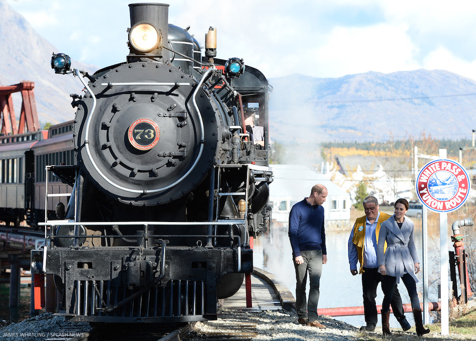 The Duke and Duchess of Cambridge cling on as they negotiate a tricky bridge, after taking a look at a steam train on a visit to Carcross, Yukon, Canada, on the 28th September 2016.