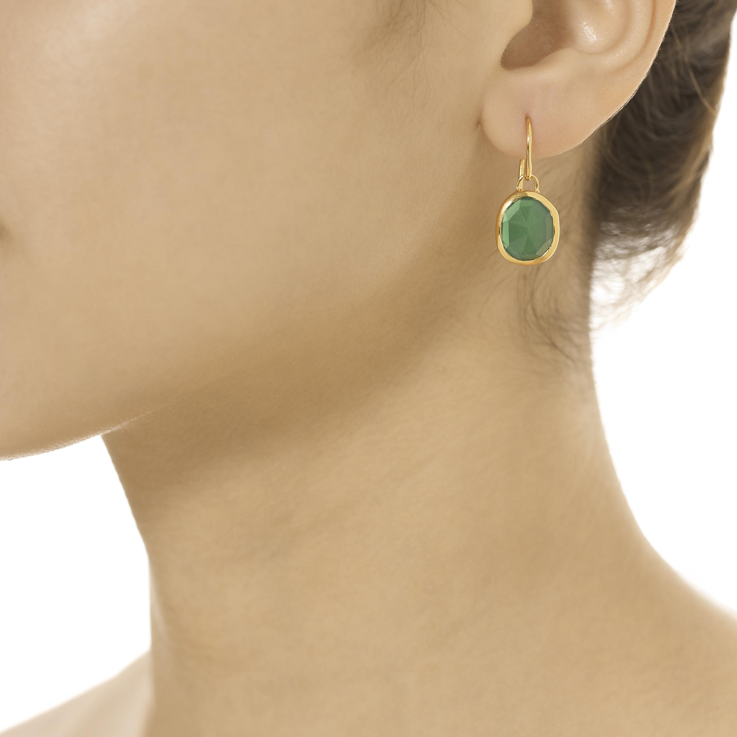 A model wearing the Monica Vinader Siren earrings