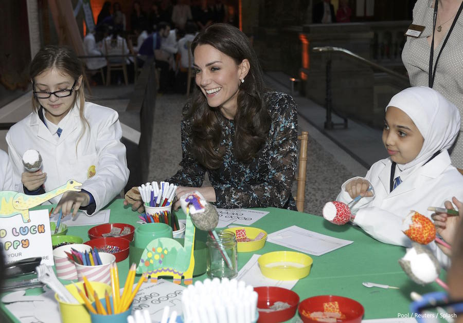 Kate Middleton doing arts and crafts with schoolchildren