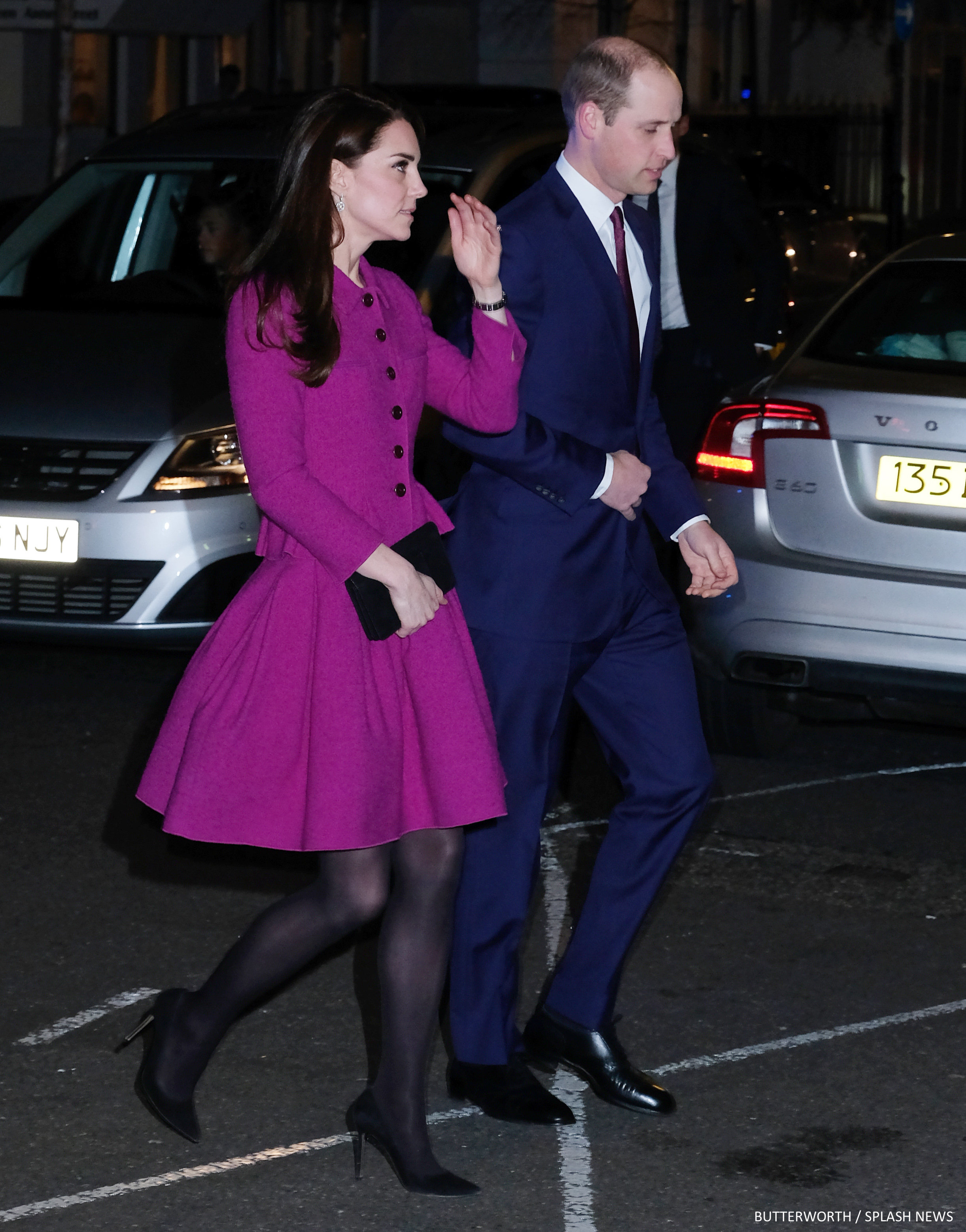 The Duke and Duchess of Cambridge arrive to a charity gala in central London. The Duchess of Cambridge wore a bright purple evening dress as she made her way into the Guild of Health Writer's Conference at Chandos House.