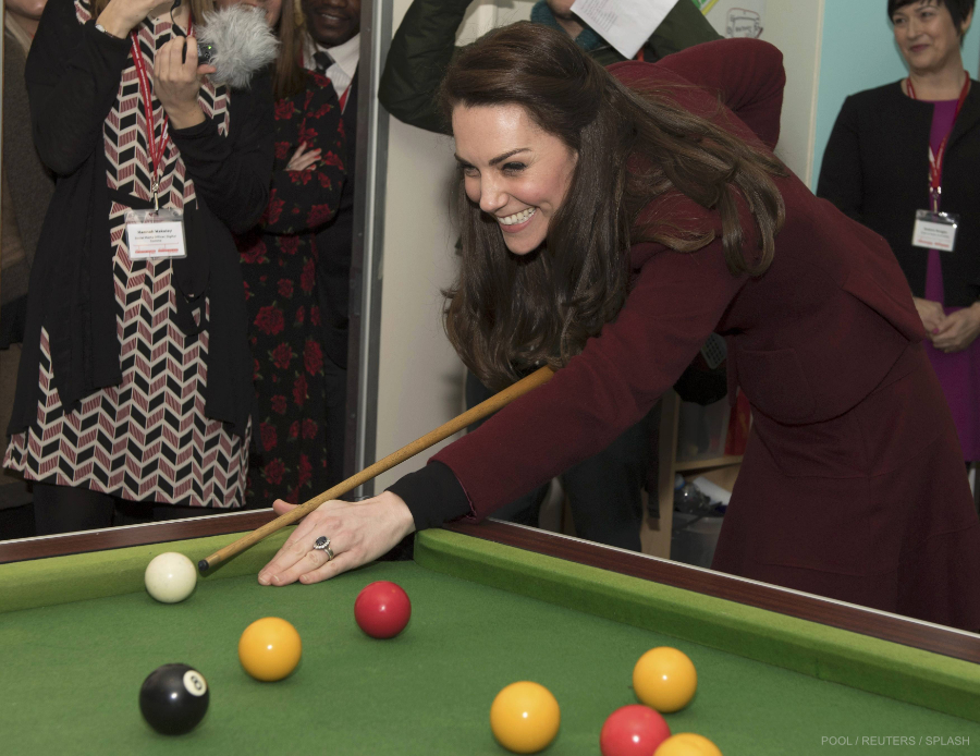 Britain's Catherine, Duchess of Cambridge, plays pool during her visit to MIST, a child and adolescent mental health project in Pontypool
