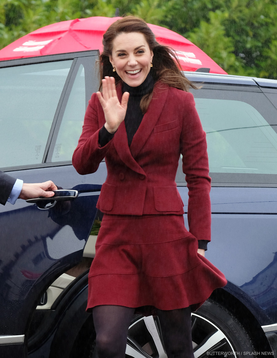 The Duchess of Cambridge smiles and waves as she arrives in Caerphilly, Wales.
