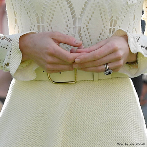 Britain's Catherine, Duchess of Cambridge attends a tea party at Buckingham Palace in London wearing an Acne Studios belt