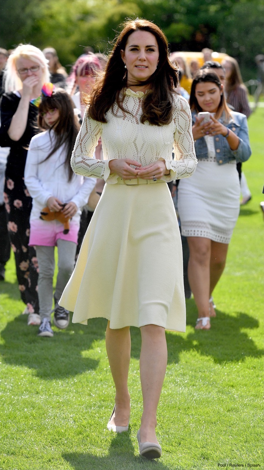 Britain's Catherine, Duchess of Cambridge attends a tea party at Buckingham Palace in London, Britain on May 13, 2017. The Party at The Palace honoured the children of those who have died serving in the Armed Forces. Pictured: Catherine, Duchess of Cambridge wearing the Monsoon Fleur wedges