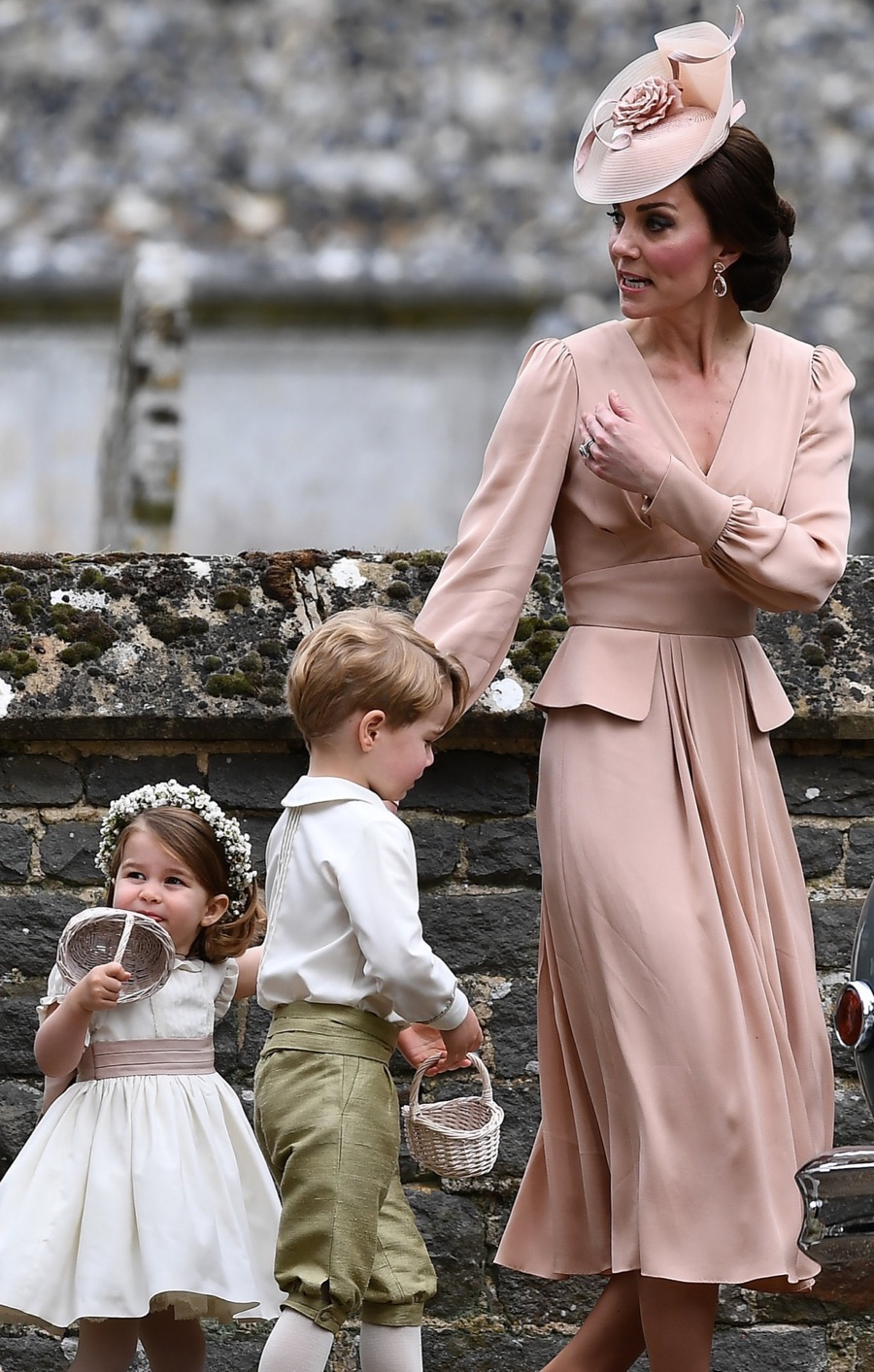 Kate wears pink alexander mcqueen dress to pippa middleton for Kate middleton wedding dress where to buy