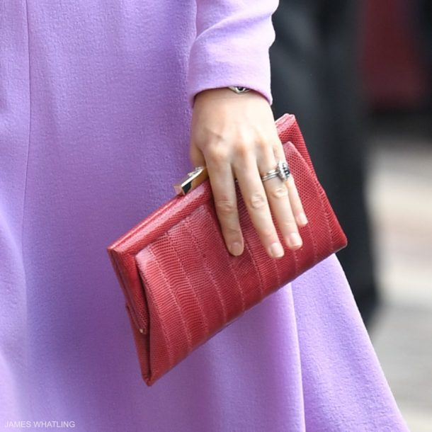Kate Middleton carrying a red Anya Hindmarch clutch bag