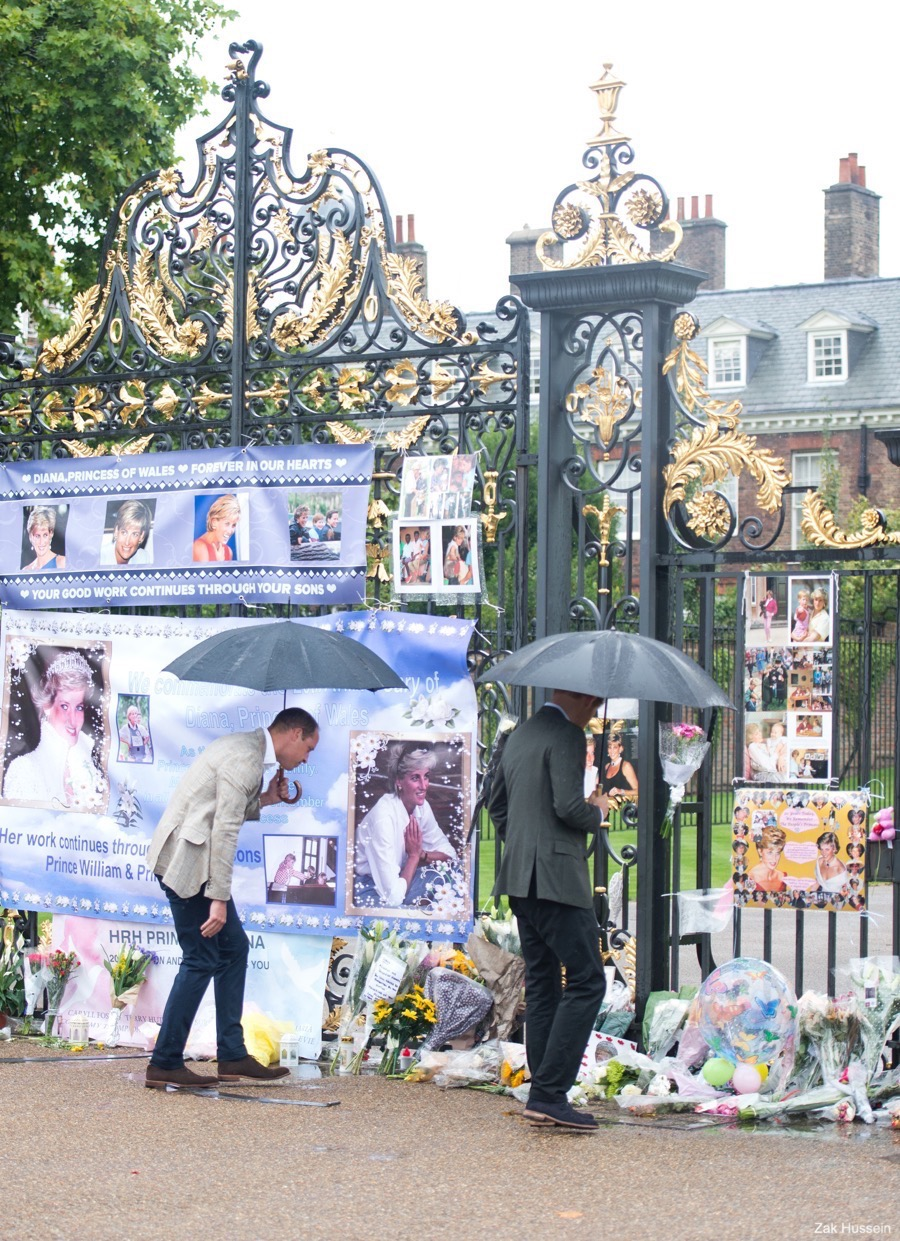 Prince William and Prince Harry viewing tributes at Kensington Palace
