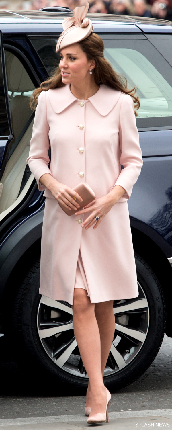 Kate Middleton, while pregnant with Princess Charlotte, wearing a pink coat
