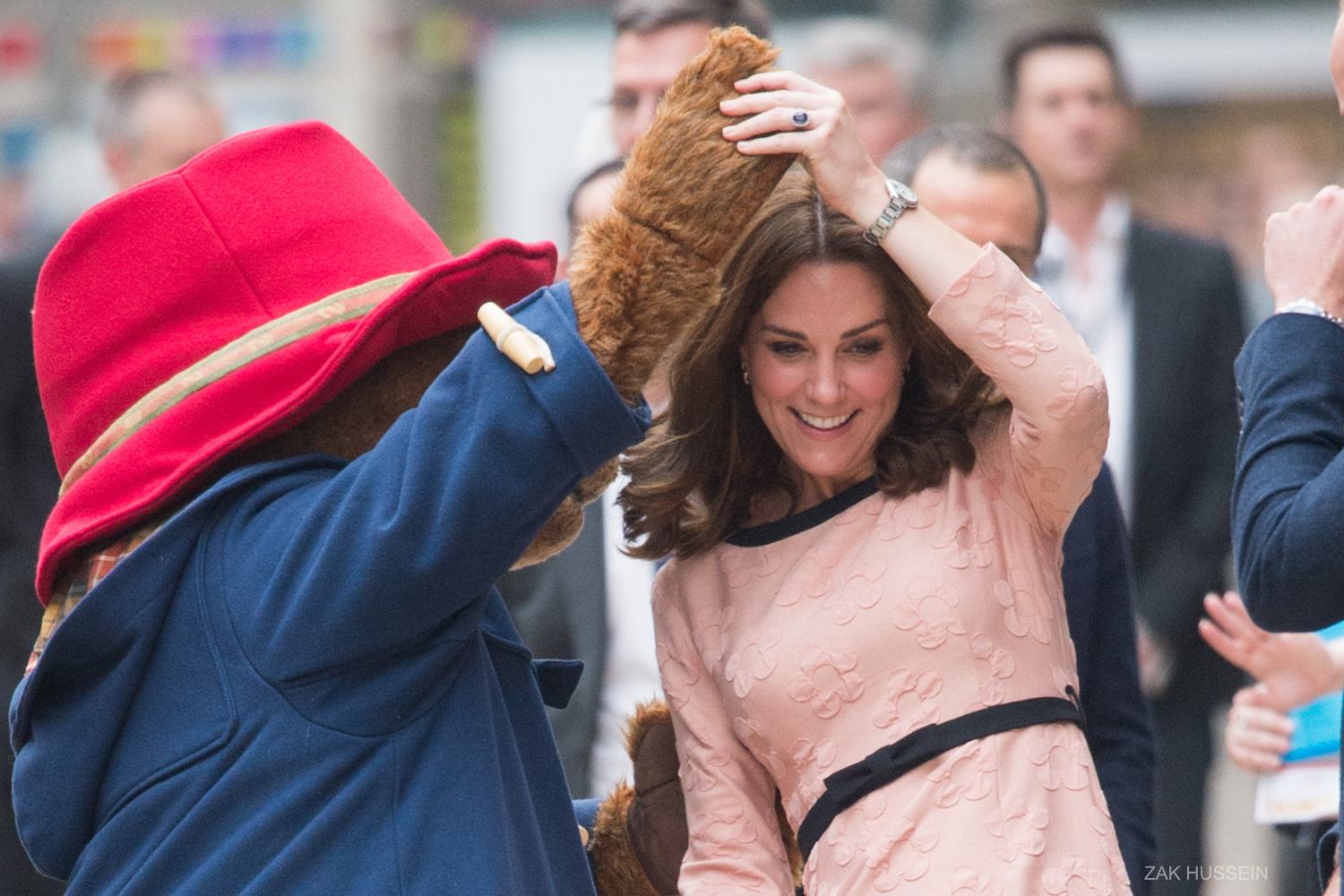 Kate Middleton dancing with Paddington Bear at Paddington Station