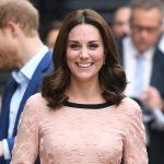 Kate Middleton visits Padding Station and meets Paddington Bear! She wears a pink dress by Orla Kiely