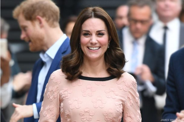 Kate Middleton visits Padding Station and meets Paddington Bear! She wears a pink dress by Orla Kiely