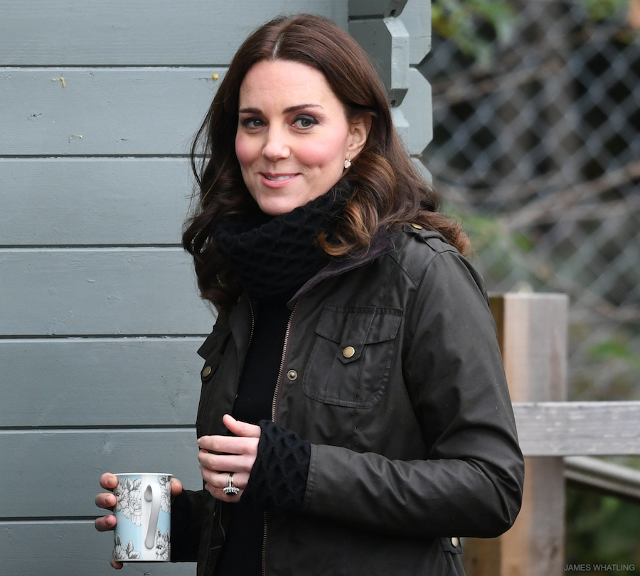 Kate middleton clutching a cup of tea
