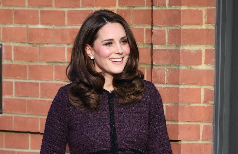 Kate repeats Seraphine Maternity coat for visit to the Rugby Portobello Trust