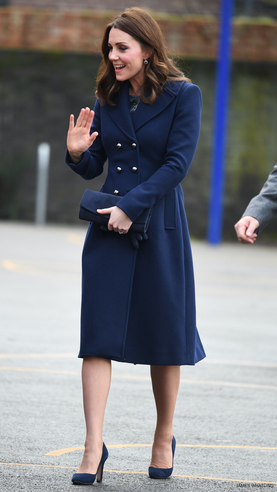 Kate Middleton wearing the Hobbs Gianna Coat and carrying her Stuart Weitzman clutch bag