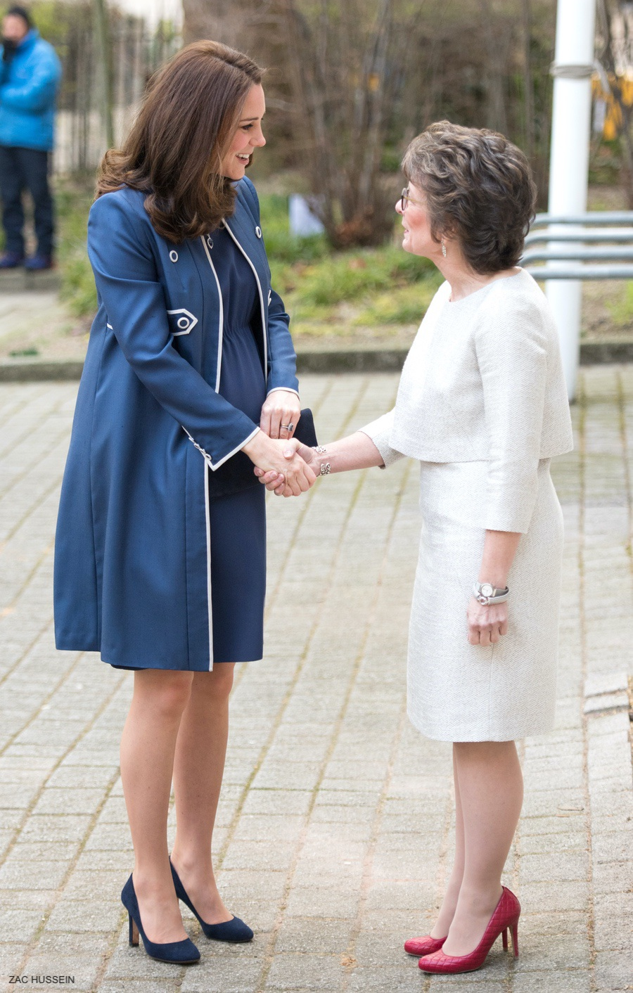 Pregnant Kate wearing a blue dress and jacket at the RCOG today