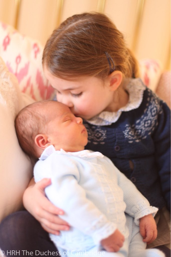 Photograph of Princess Charlotte kissng Prince Louis taken by HRH Duchess of Cambridge