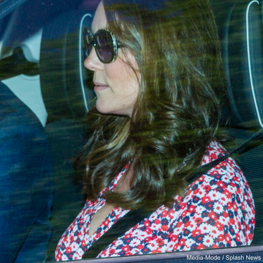 Kate Middleton wearing a pink floral Michael Michael Kors Dress