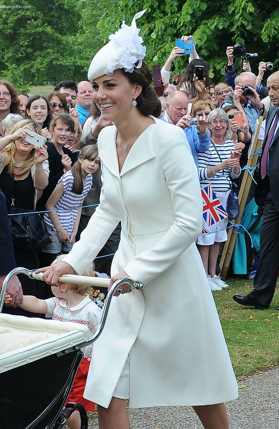 Kate Middleton at Princess Charlotte's christening wearing a cream Alexander McQueen coat