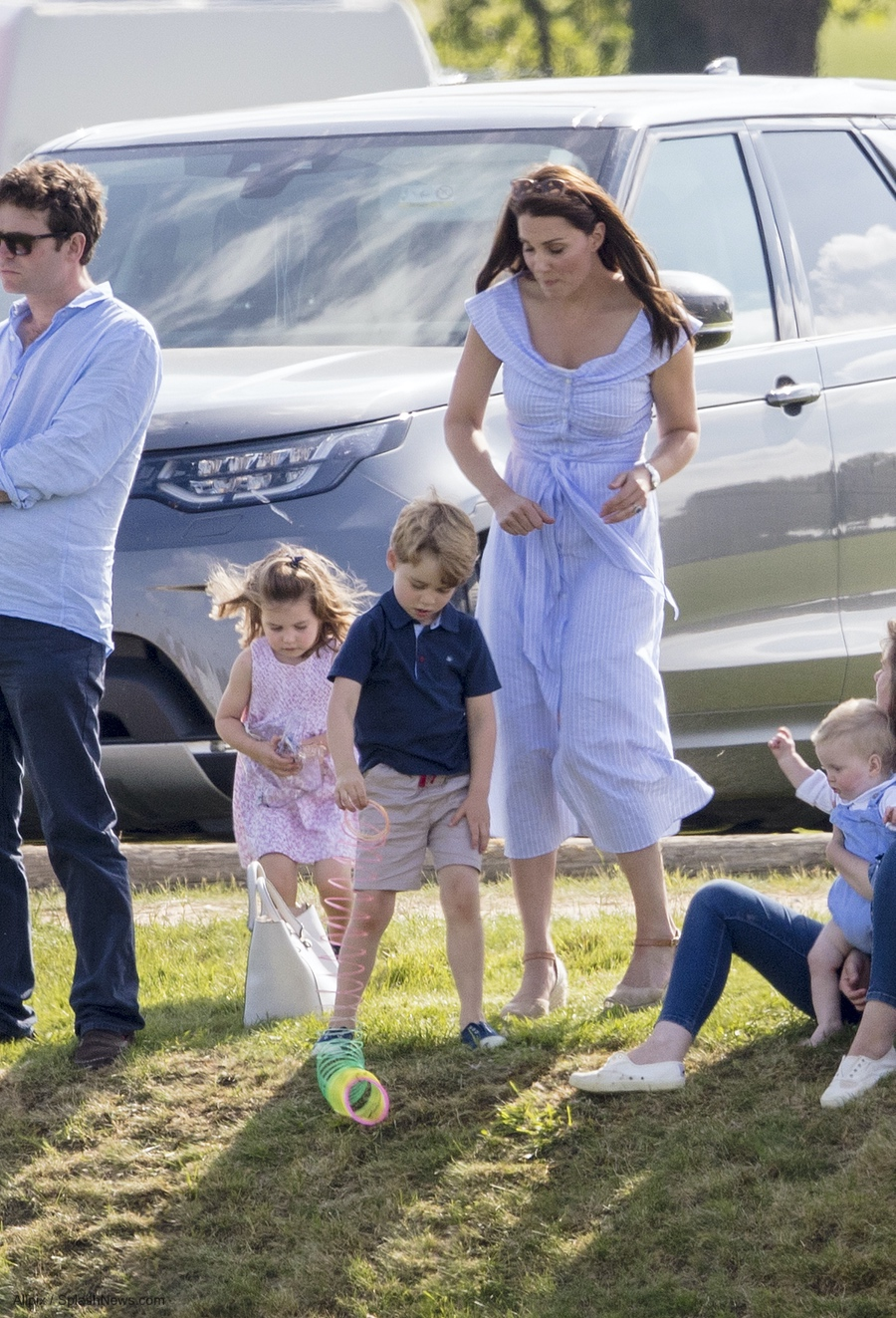 Kate with the children at the polo