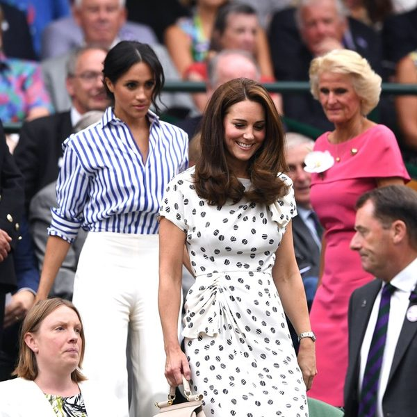 The Duchess of Cambridge (Kate Middleton) and the Duchess of Sussex (Meghan Markle) at Wimbledon 2018