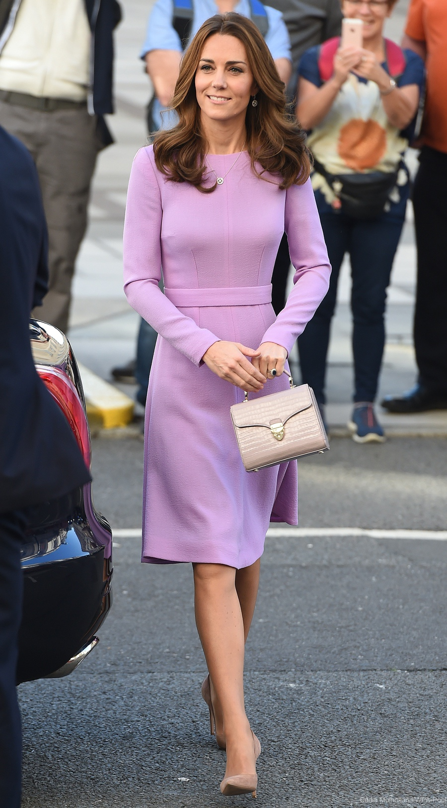 Kate Middleton's outfit at the mental health summit in Oct 2018. Duchess Kate wore the purple dress in Hamburg, Germany last year too.