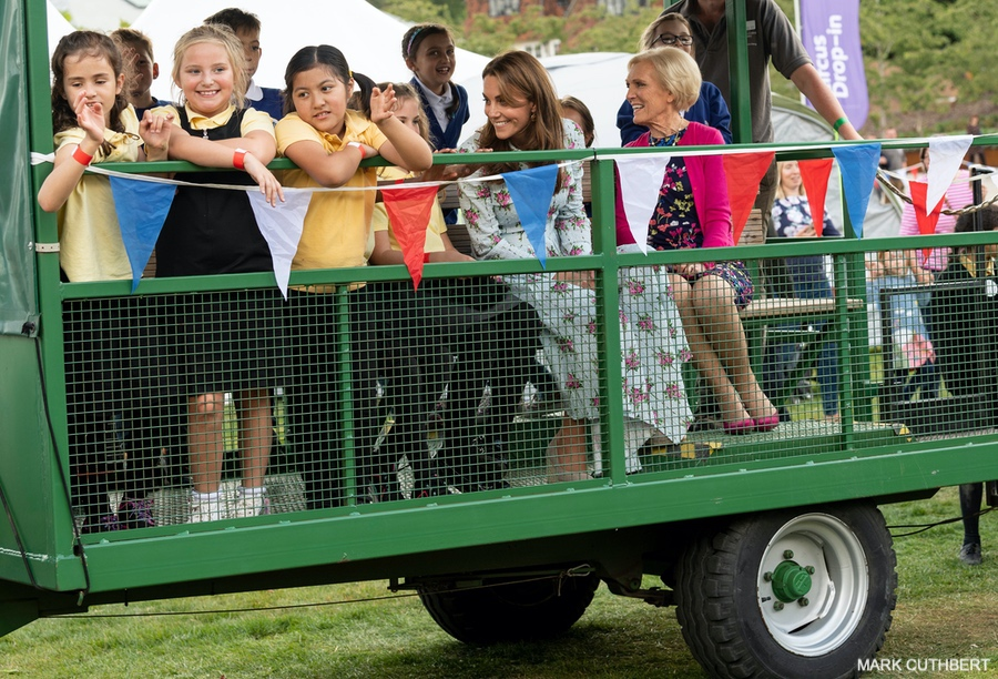 The Duchess of Cambridge riding on a tractor trailer