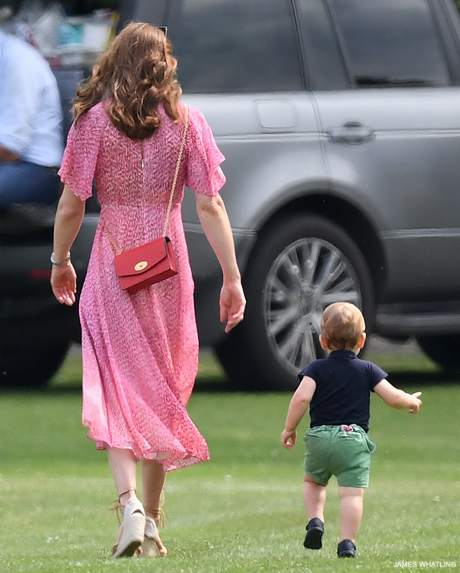 Kate carries a red bag at the polo match, while Prince Louis runs after her