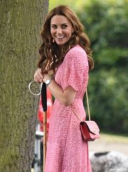 Kate middleon looks pretty in pink dress as se attends the polo match with her three children