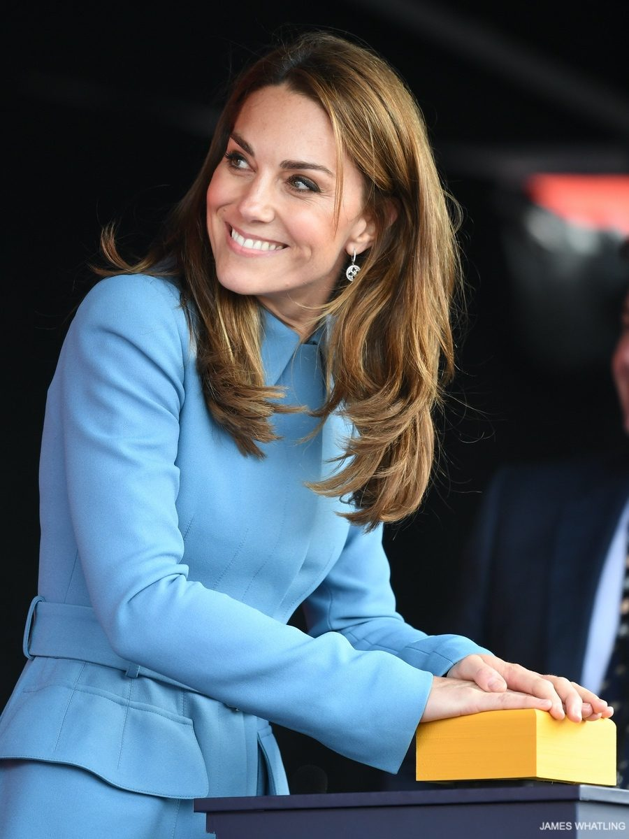 Kate hits the button to christen the ship