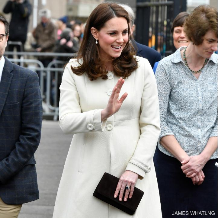 Kate Middleton carrying a black clutch bag