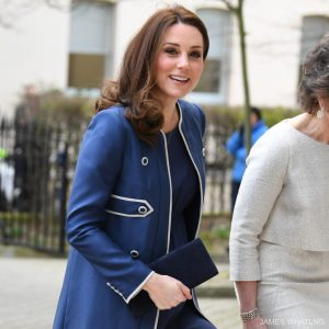 Kate Middleton carrying a blue clutch bag