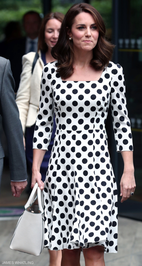 Kate Middleton carrying a white handbag